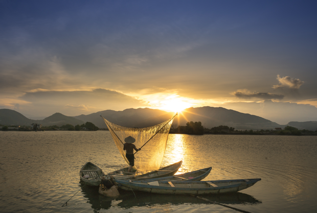 image of a vietnamese fisherman on a river